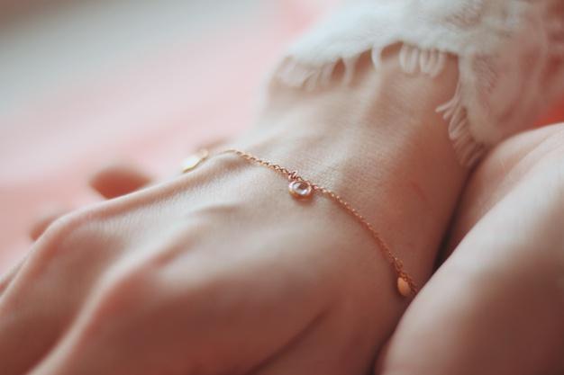 closeup-shot-female-wearing-fashionable-bracelet-with-charm-pendants_181624-21048